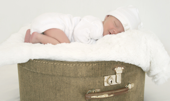 Sleeping baby on suitcase photography