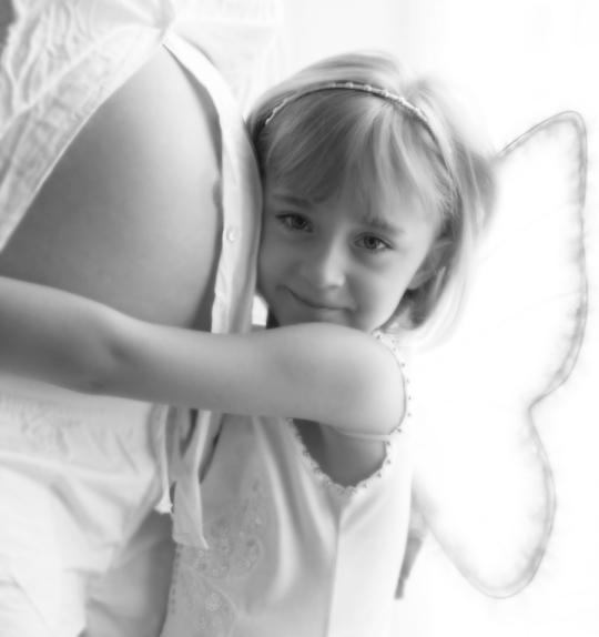 Girl hugging preggy tummy
