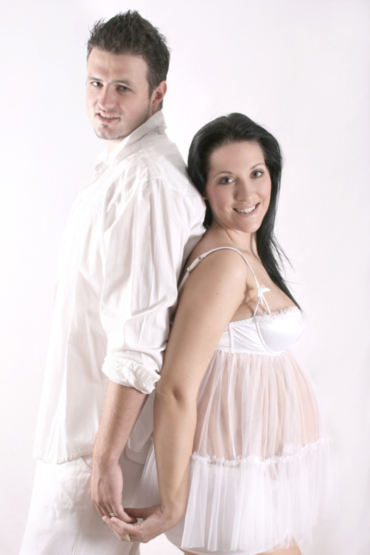 Pregnancy couple in white